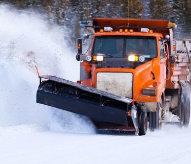 snow plow blades attachment on equipment