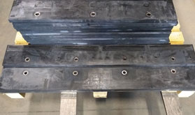 Picture of a rubberized carbide snow plow blade