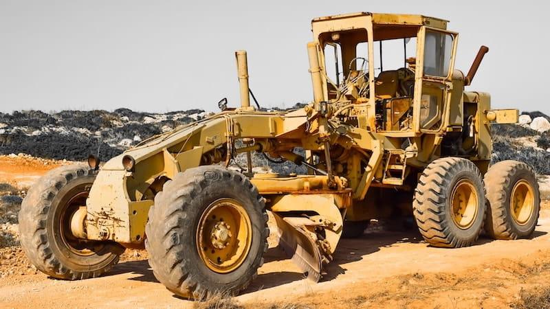 carbide grader blades on a motor grader plow machine