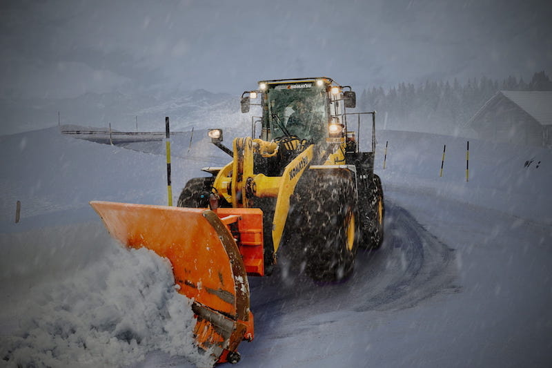 snow plow pushing snow