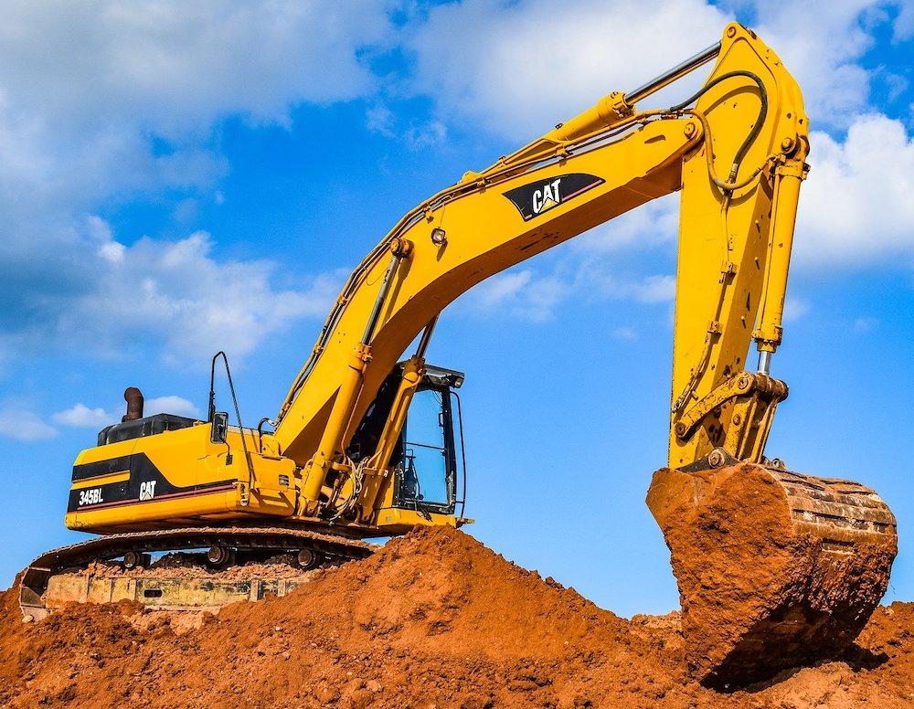 CAT 345BL Excavator Undercarriage Digging in Dirt