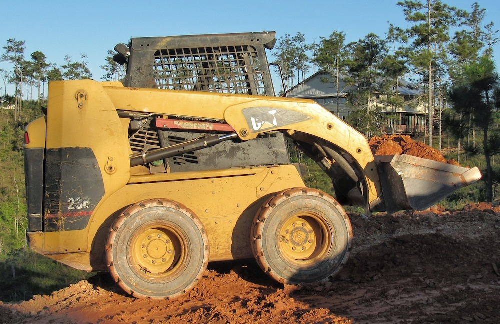 Old CAT 236 Skid Steer Repaired with aftermarket undercarriage parts